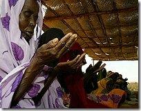 sudanese pray